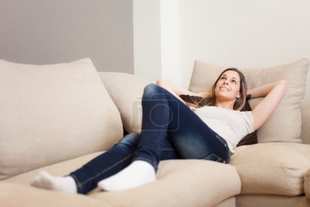 Photo for Young woman relaxing on her couch - Royalty Free Image
