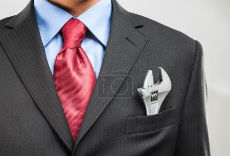 Adjustable wrench in his pocket