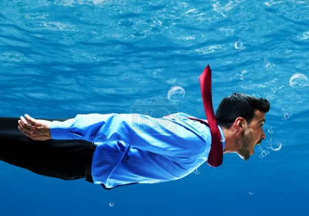 Businessman swimming underwater