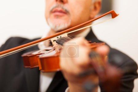 Musician playing his violin