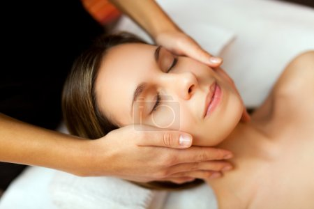 Woman having a facial massage