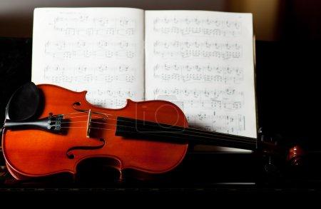 Violin lying on piano