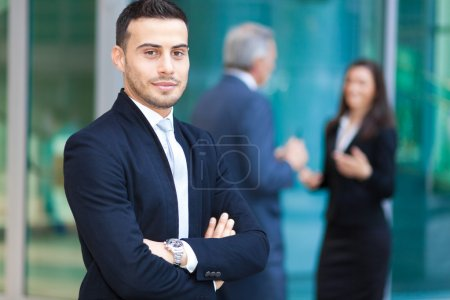 Man in front of business team