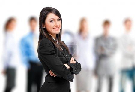 Foto de Businesswoman in front of her team - Imagen libre de derechos