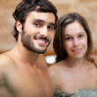Young couple relaxing in a spa...