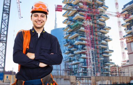 Worker in front of a construction site