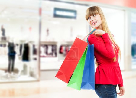 Photo for Young woman holding shopping bags - Royalty Free Image
