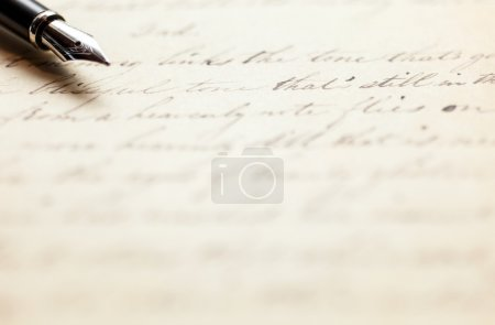 Pen on an antique handwritten letter