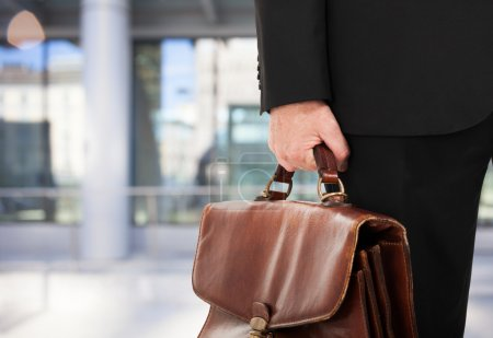Photo for Detail of a businessman holding a briefcase - Royalty Free Image