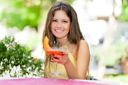 Woman having an aperitif outdoor
