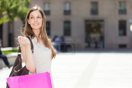 Woman shopping in a city