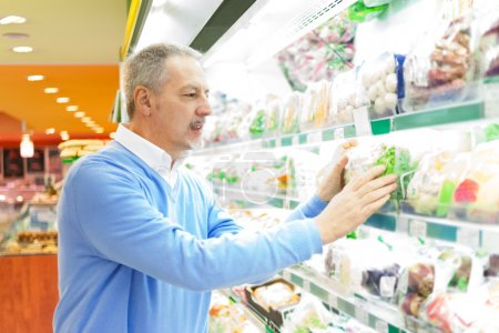 Man buying food in a supermarket