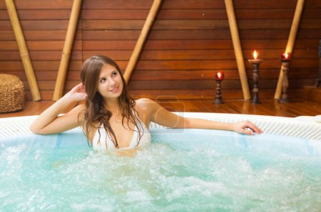 Beautiful woman relaxing in a spa...