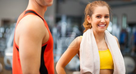 Photo for Portrait of a sporty young woman with towel in a gym - Royalty Free Image