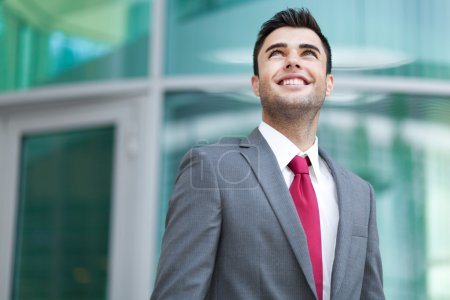 Handsome businessman looking up