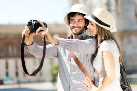 Couple taking a selfie in city