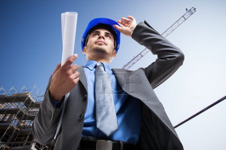 Architect at work in construction site