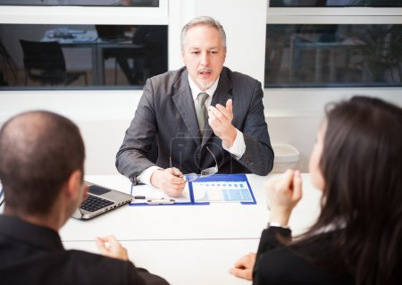 Businessman talking to couple
