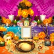 Traditional mexican Day of the dead altar with sug...