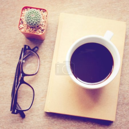 Black coffee on notebook