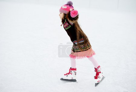 Winter portrait of ice skating child girl