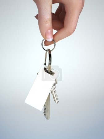 Hand holding keys with key chain