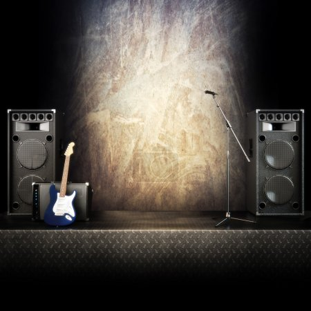 Microphone, electric guitar and speakers with diam...