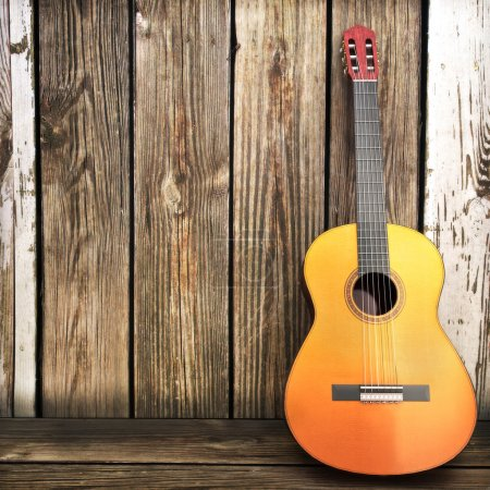 Photo for Guitar leaning up against a wooden fence. Room for text or copyspace - Royalty Free Image