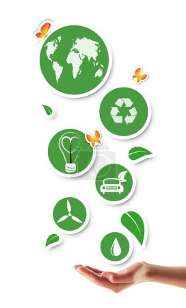 Hand holding green ecological icons