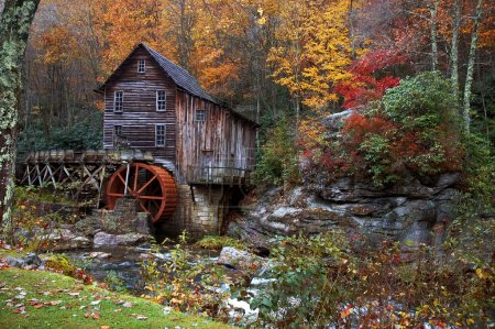 Photo for Beautiful colorful October autumn colors surround the Glade Creek Grist mill in West Virginia. A very popular destination for tourism in the fall. One of several of this mill I have in my gallery. - Royalty Free Image