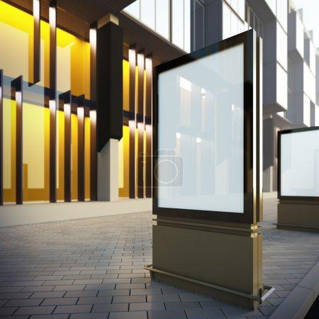 Photo pour Panneau d'affichage vertical dans le centre-ville. une disposition de modèle vierge illustration 3d du billboard modern à la rue. - image libre de droit