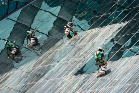 window cleaners cleaning a high rise office building
