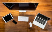 Computer ,laptop , tablet , smart phone on wood table