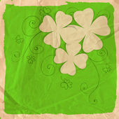 St Patrick day card three four leaf paper clovers on green background with grunge frame hand - drawn floral ornaments and old crumpled paper texture vector illustration contains gradient meshes