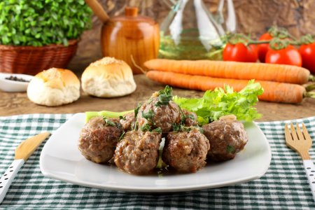 Meatballs stewed with vegetables