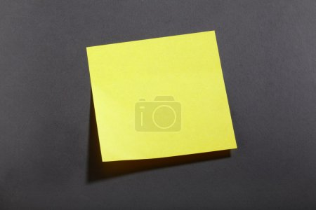 Yellow sticky note on blackboard