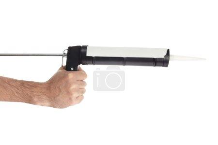Applying silicone with caulking gun tool