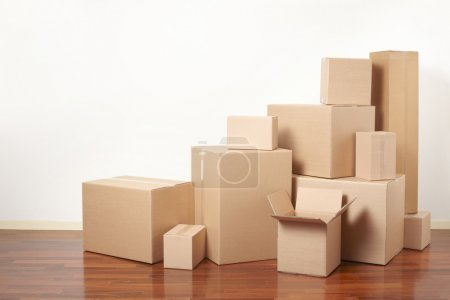 Photo for Cardboard boxes stack in apartment, moving day - Royalty Free Image