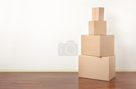 Photo for Cardboard boxes in apartment, moving day - Royalty Free Image