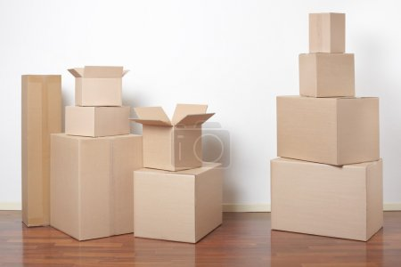 Photo for Cardboard boxes in interior, moving day - Royalty Free Image