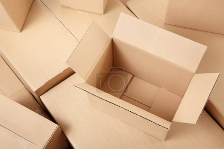 Photo for Cardboard boxes background, open box on top - Royalty Free Image