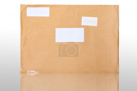 Photo pour Enveloppe brune avec des reflets - image libre de droit