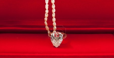 Diamond ring and pearl necklace
