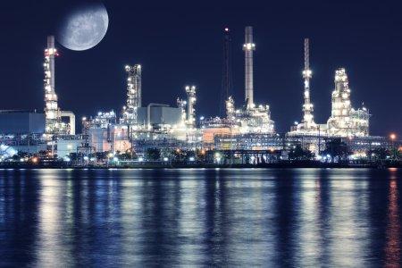 Oil refinery plant night scene