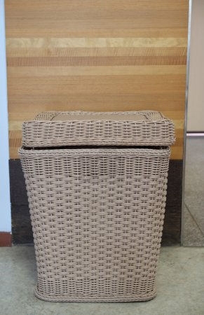 Bamboo basket for keeping cloths after used in the room
