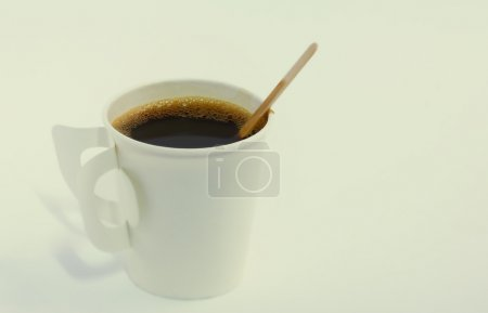 Steaming paper coffee cup in vintage style