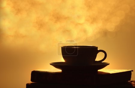 Morning coffee cup on wooden board with bokeh background