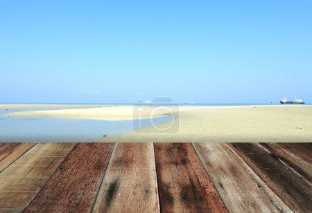 Wood floor with sky, sand, beach