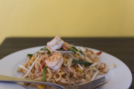 Pad thai- stir-fried  noodles . Thailand's national dishes