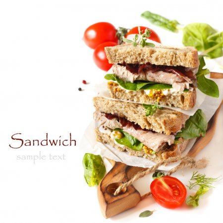 Photo for Sandwiches with meet, vegetables and mustard on crusty fresh sliced rye bread. - Royalty Free Image